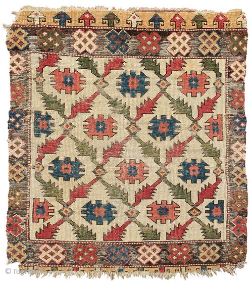 White ground rug with tribal emblems, Cappadocia, East Central Anatolia, 18th Century, 111 x 90 cm (3 feet 8 inches x 3 feet) The carefully drawn pattern of interlocking sprigs of sawtooth  ...