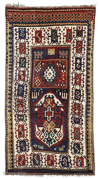 """Borchalo Kazak prayer rug Southwest Caucasus circa 1870 220 x 117 cm (7'3"""" x 3'10"""")  Alg 1528 symmetrically knotted wool pile on a wool foundation A rare and unusual rug characterised by a two panel design: the  ..."""