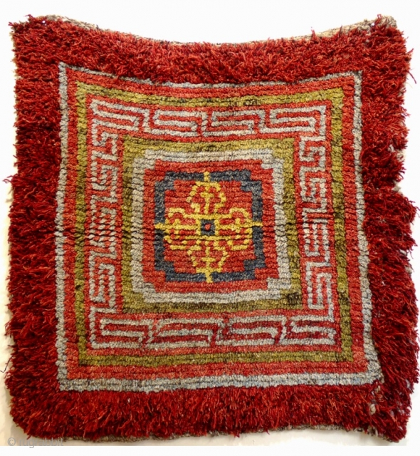an C18th Tibetan Wangden Lamas seating meditation square. These thick heavy rugs were woven  in the remote Wangden valley of Tibet and used in the monasteries there as insulation from the  ...