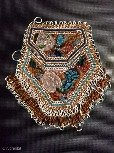 Charming antique American Indian beadwork purse the finest of this type I have seen.