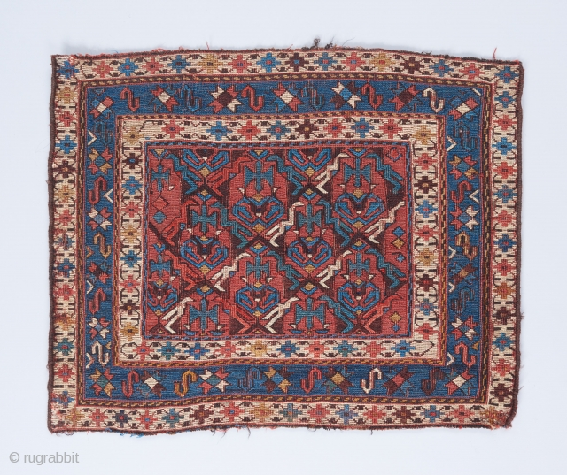 "Caucasian soumak bag with great negative/positive space interplay in the field . 1'10"" x 1'7""."