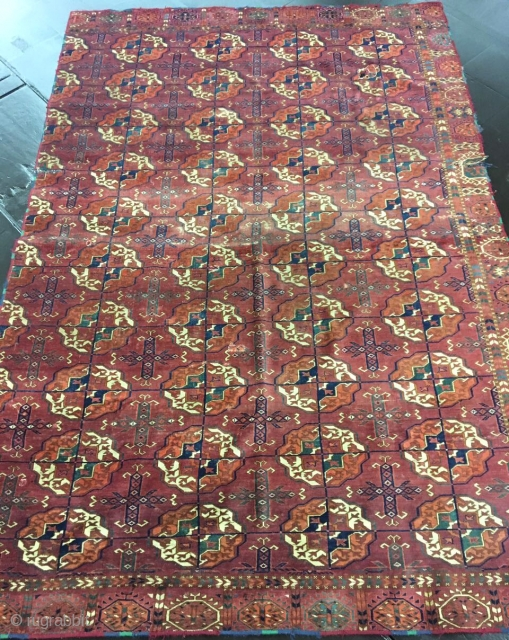 lush velvety Tekke Turkmen main carpet with rounded guls. fragmented at sides, missing a border.