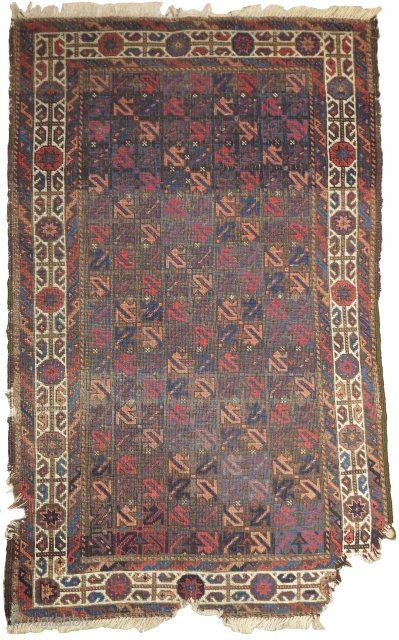small symmetrically knotted Baluch rug. The field design is composed of a repeat made up from the tendrils of harshang blossoms (blossoms excluded) of the type more typically found in the borders  ...