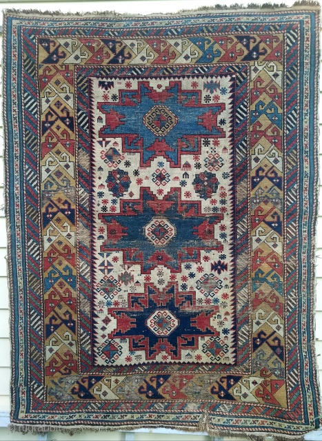 Ivory field Leshgi star rug- about 4.7 x 3.8.  Beautiful color including yellow ground border.  Pretty much intact. Has wear, oxidation, glue residue on back, and small slit lower end  ...