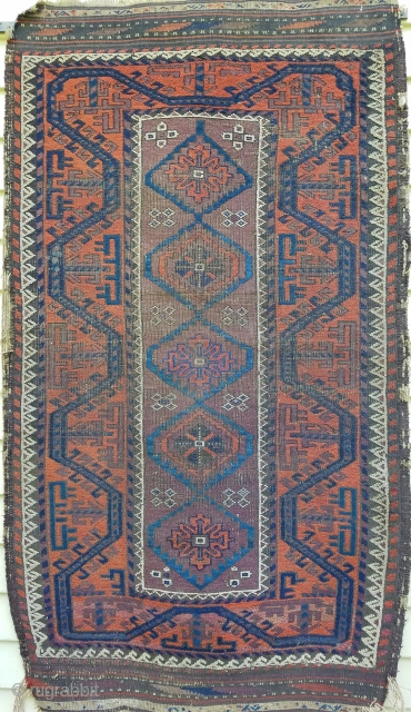 """Baluch - about 34"""" x 59"""".  Great 'boat border, nice use of ivory, purple and blues. As found with wear and side selvage unravelling."""