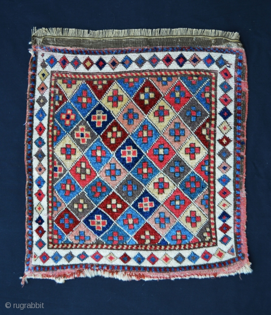 "A pair of rare, early 19th century knotted-pile Shahsevan bag-faces with superb saturated natural dyes and soft wool. 53cm x 50cm (1' 9"" x 1' 8"")."