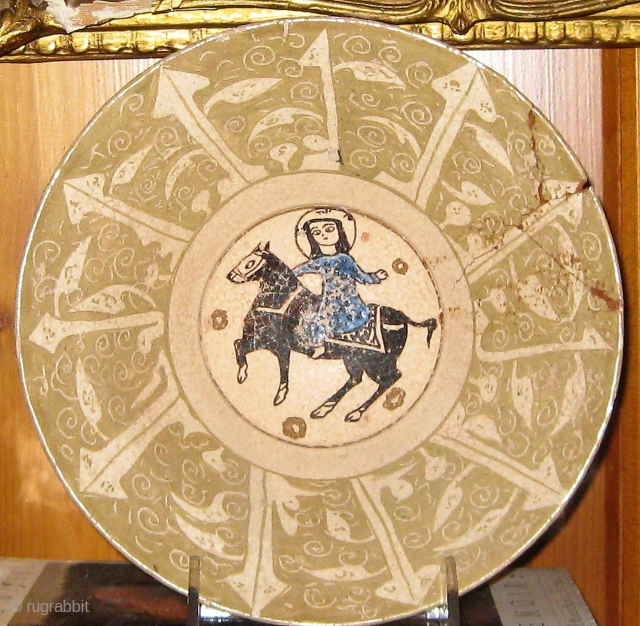 Lusterware bowl, Samanid/ Seljuk style, of conical form on a straight foot, decorated with a central horseman within a circle, surrounded by a foliate or tree-motif pale green and cream border. Approximately  ...