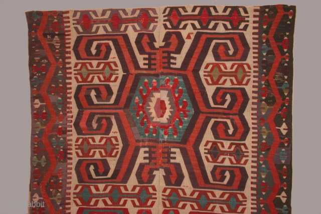 Anatolian kilim with three large central medallions, 5 x 14 feet, circa 1800. condition: substantial reweaving of black in borders, some reweaving in the field as well. The composition of the elements  ...