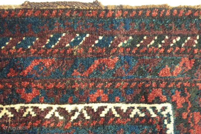 """Baluch bag face, Northeast Persia, circa 1880, size 24"""" x 23"""" (60 x 58 cm),these intriguingly dark, moody colors can be captivating to one who is drawn to Baluch weaving. That's the  ..."""