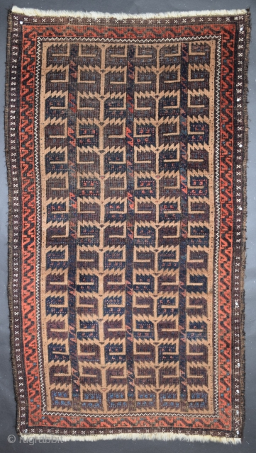 """Baluch rug, size 35"""" x 64"""" (88 cm x 162 cm), several features contribute to the excellence of this rug, both the field composition and border constructs are classically 'Baluch' executed with  ..."""