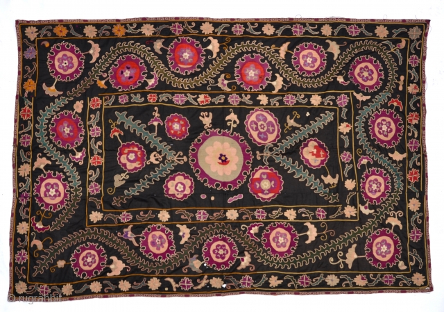 """Antique Uzbek Suzani An early rich Uzbek Suzani with beautiful silk medallions and floral themes on cotton background. 102"""" x 69"""""""