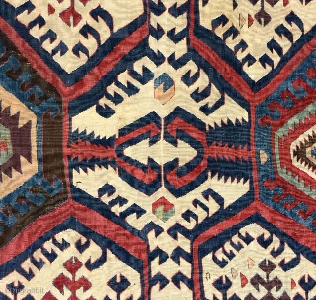 Early White Ground Anatolian Kilim.  The strong animated design of this old Hotamis kilim is explosive, but well balanced.  There are areas on both selvedges that are intact indicating the  ...