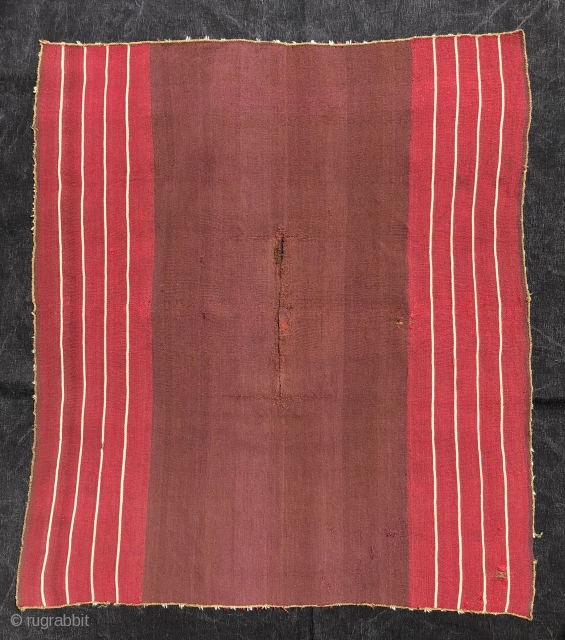 """This Aymara warp-faced plain weave (kawa-ponchito) or small poncho with a """"vacant center"""" layout dates to the first quarter of the 19th century. The arrangement of the stripes and the un-patterened center  ..."""