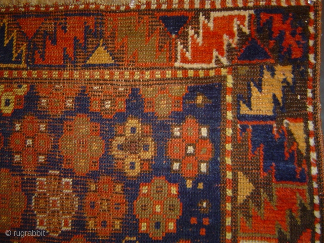 Antique Kazak small rug with 34 Rosettes on Blue, Serrated Leaf Border,  34 x 38 inches. Good condition with visible wear, sound foundation. Nice small format.