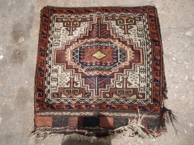Ivory ground baluch bagface with goats or dogs,original kilim backing,nice bag with good colors and design.Size 2*2.E.mail for more info and pics.