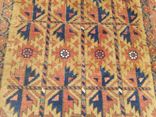 "Camel ground Baluch rug with good colors and design,as found without any repair or work done. Size 5'2*2'11"".E.mail for more info and pics."