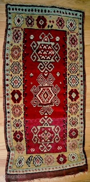 Central Anatolia, Konya region, possibly woven as a long yastik, c 1880, with archaic geometric medallions, approx 24 x 45 inches(50 x 130 cm). Thick, perfect pile with lustrous wool, natural dyes  ...