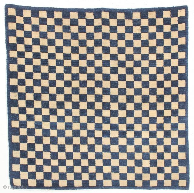 Square Tibetan meditation rug, late 19th. Century. Measuring 3-00 x 3-1 ft