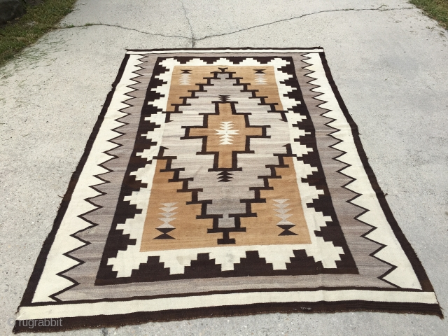 "Very early 20th century large Navajo measuring 5'10""x8'6"", has a few holes and needs some other touch ups."