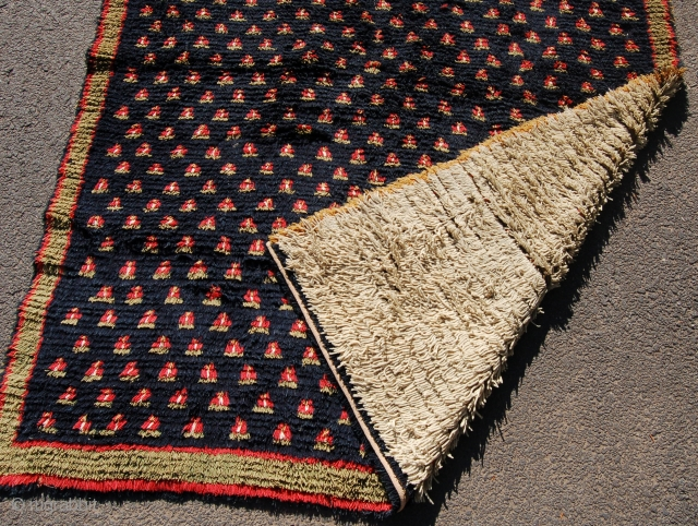 Interesting double sided Finnish rya rug. Early 19th century.  Some small wear or moth damage otherwise full pile. Aprox. 2 x 140cm.