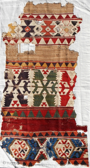 c. 1800 Central Anatolian kilim fragment. bold, dramatic scale. Excellent color with real camel. Conserved and mounted on linen.