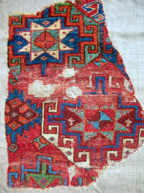 17th-18th c. Anatolian Sivas rug fragment. Conserved and mounted on linen.