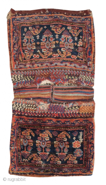 This Afshar double chanteh set, resembling a miniature pair of saddle bags, was woven with the utmost care in exceedingly soft wool. Each bag face draws a row of three 'boteh' paisleys  ...