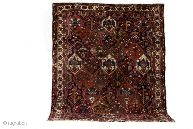 Bachtiar, 290 x 225 Cm. 9.6 ft. x 7.5 ft.  Wool knotted on cotton.  1930. 80 years old.   Fields of Bachtiar.  Each field depicts a garden. Beautiful eggplant red.   subtle color combination  ...