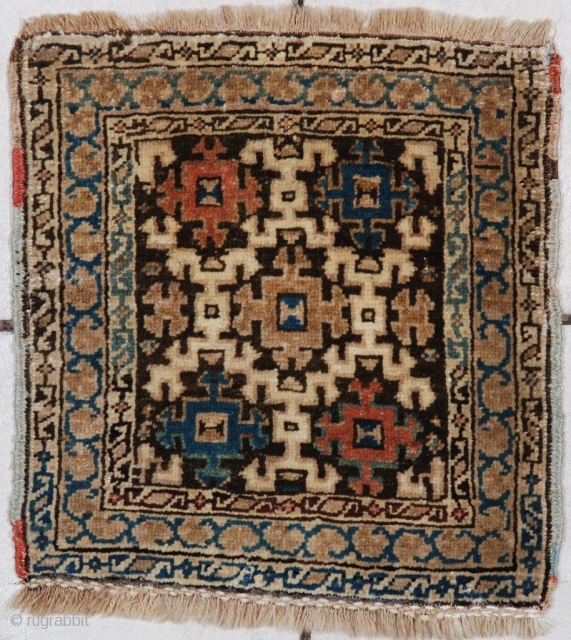 """#7040 Antique Kuba Caucasian rug  This very cute antique miniature Kuba Oriental rug measures 1'4"""" x 1'4'. It has a brown field with a large ivory snowflake image covering most of the  ..."""