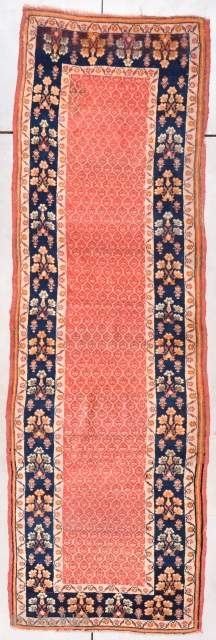 """Turkish Runner 3'0"""" X 9'7"""" #7869 This circa 1930 Turkish runner measures 3'0"""" X 9'7"""". The center field is a pale red color with a lattice work design where every opening in the  ..."""