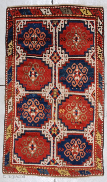"""#7283 Kazak  This circa 1875 Caucasian Kazak rug measures 3'9"""" X 6'6"""". It has the Mogan motif in red and blue with ivory negative spaces.  It has one narrow border with the  ..."""
