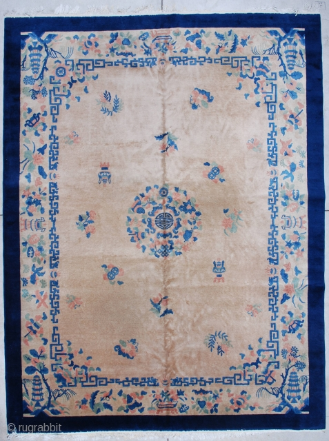 """#7292 Art Deco Chinese Rug  This circa 1930 Art Deco Chinese Oriental rug measures 9'0"""" X 11'8"""". It has a light café au lait field with a center medallion containing the symbol for  ..."""