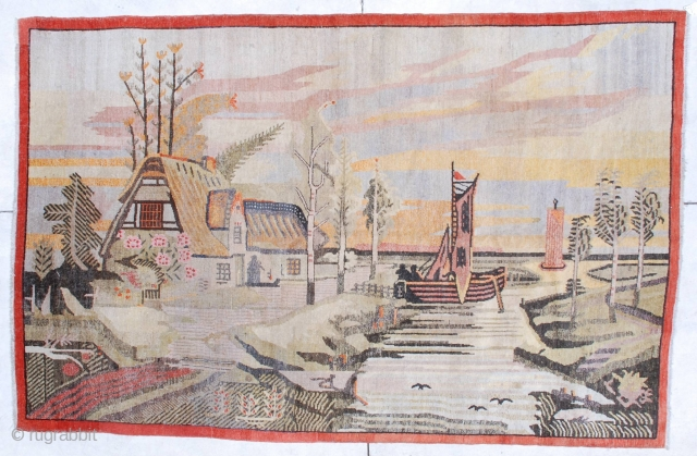 """#6795 Antique Khotan Rug  This circa 1920 antique Khotan rug measures 5 '10"""" x 9' 0 """". It has a fantastically drawn scene of a house on the water with a lovely tiled  ..."""
