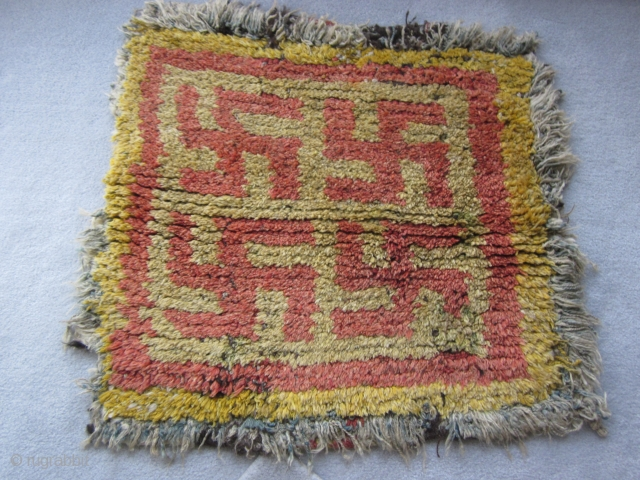 Tibetan wangden monastic meditation seating square with a Five swastika design. This is a rare and early piece.