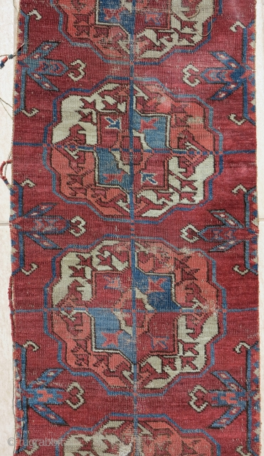 old Tekke Turkmen main carpet fragment from an early or mid century piece. A vertical strip with 10 guls representing the full vertical height of the field.  Several old and strange  ...