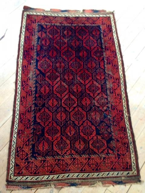 Good Baluch rug with thick soft pile, glowing colors and some holes:)