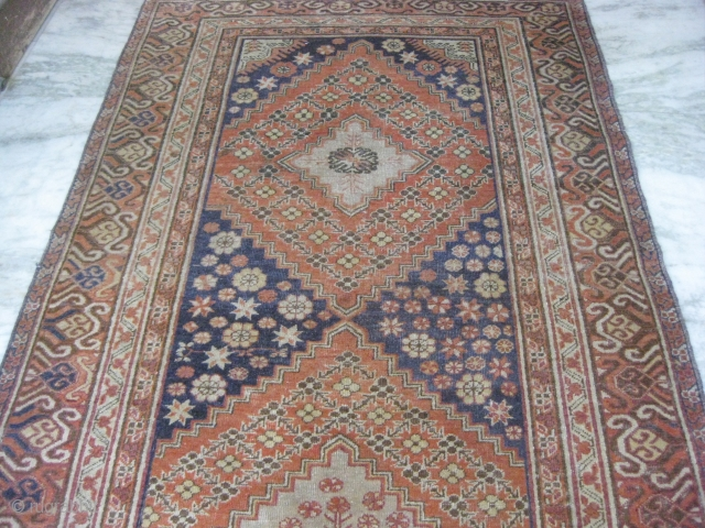 An old Khotan rug in mint condition, size 10 x 5 feet approximately.