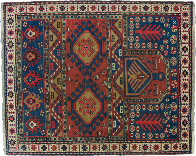 Unusual antique Karabagh rug with Mehrab design. Very good saturated natural dyes and even low pile with some small areas of repiling. 127x105cm