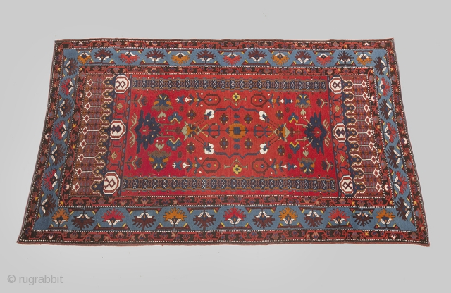 P28 Antique Ardebil 212x127cm, Circa 1900. Rare antique Ardebil rug. Two stylised hanging lanterns from each end on a vivid red ground and pillars running at each side, framed with a very  ...