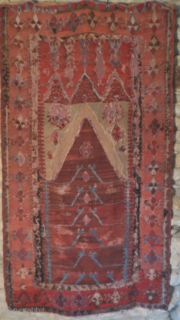 An early Obruk prayer kelim, 44 in x 80 in. Probably 18th century. Much of the black is oxidized, which is why part of the mihrab is missing. It has been sewn to  ...