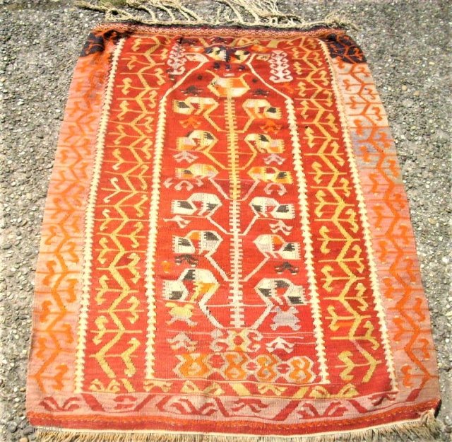 old anatolian prayer kilim. Size: 90 x 123 cm. Some holes.
