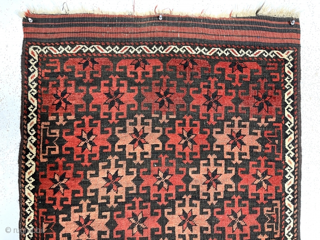 Antique small Baluch rug with very good design, excellent color and overall fair condition for the age. The array of archaic radiating medallions in diagonal bands on a lightly oxidized brown ground  ...