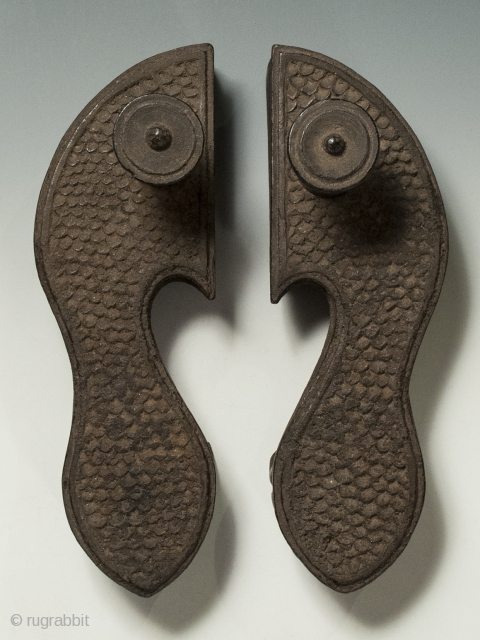 """Khadau chappals or paduka, India, Wood, 10"""" (25.3 cm) long, Late 19th to early 20th century.  A heavily encrusted pair of Indian paduka sandals with a simple scale pattern. Because leather was prohibited  ..."""