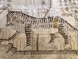 Lovely antique Khotan tiger late 19 c size 95 x 53 inches Handspun cotton foundations unusually the red outer border seems  to be natural dyes so could be a bit earlier Could use  ...