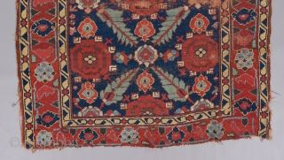 Kurdish serrated leaf lattice rug. A very early one of it's type in a rare size. Relatively restrained yet gorgeous color palette. All original in challenged condition, but the beauty remains !!  ...