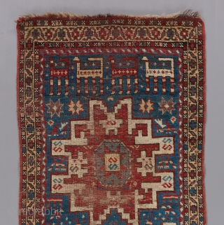 "Lovely little caucasian rug. Red and brown wefting. 4'10"" x 2'4""."