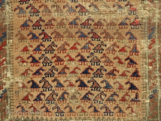 Small camel-ground Baluch rug with zoomorphic looking botehs. Very cute piece with some damage but complete.