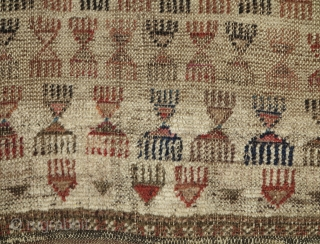 white-ground Baluch balisht with a repeat 'comb' design. A strange blend of elegance and barbarism. This is a former Basha piece. There is fuchsine in the piece.