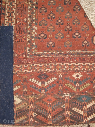 Turkmen Yomud Ensi, super soft wool, saturated color with camel wool. finely woven with asymmetrical knot open right. portions of side and selvedge missing but stabilized by patch. 125x175cm