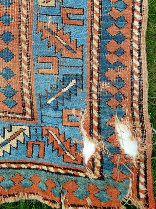 """Kazak - measuring about 8'11"""" x 6'2"""".  As found condition with overall wear, patches, crude corner repair (last picture),stain and end gouge.  Floppy handle and great size."""